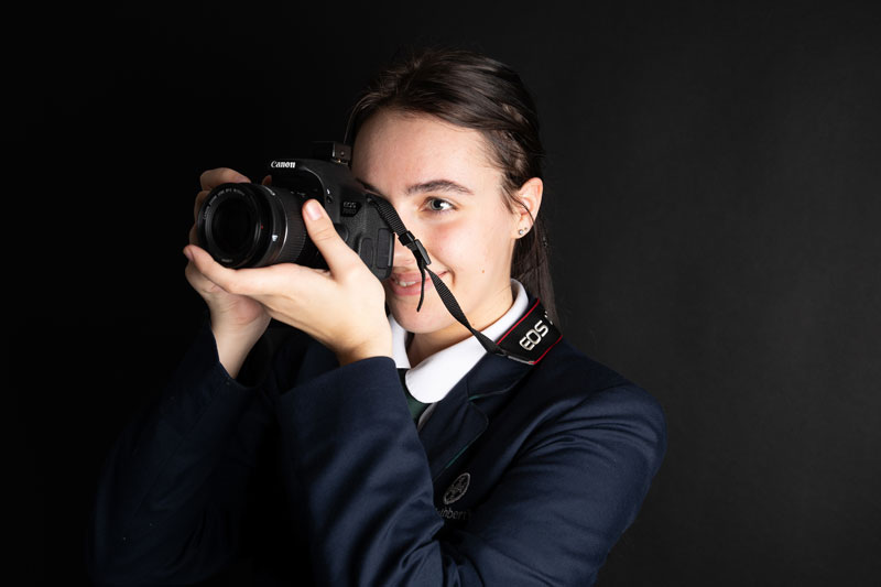 Girl with camera in St Cuthbert's photographic studio